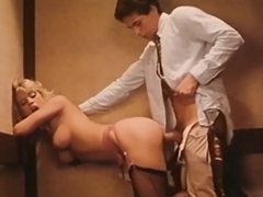 Amber Lynn fucks Peter North in a elevator