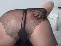 Slutty aunty, Gilly is taking off her clothes in the bedroom and getting ready to masturbate