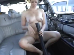 Sweet Blonde babe going at it with car wash vac in limo