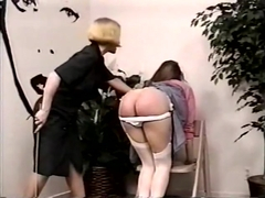 Sububurban MILF spanks and canes neighbor's daughter