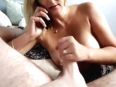 Gorgeous stepmom sucks her stepson's cock while she phone talking