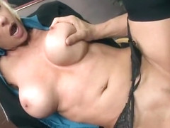 Delightful busty MILF Emma Starr in office