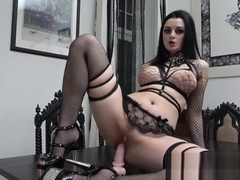 Slutty goth rides and sucks her dildo