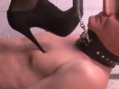 Sexy mistress tramples on an obedient slave. Foot worship.