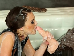 Cum covered lezzie gets strapon fucked