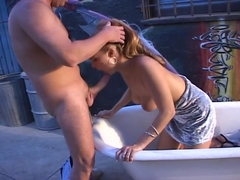 Autumn Haze Gves A Wet Blowjob In An Outdoor Bathtub