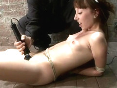 Classy Emma Haize performing in BDSM video