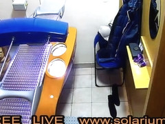 Hot Horny Girls masturbates in Public solarium