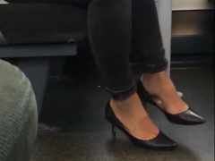 Candid heels dangling on train