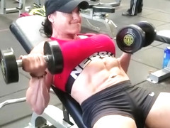 Female Bodybuilders pumping muscles