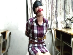 Chinese rope tied and ballgagged